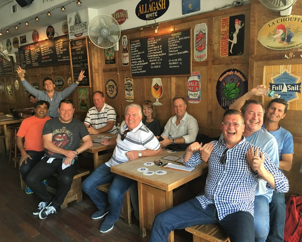 tour group enjoying a bread at tables in bar