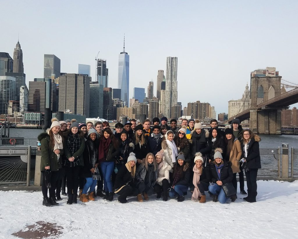 school group posing in front of hudson river in the snow